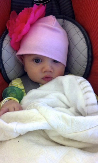 Baby with flower cap