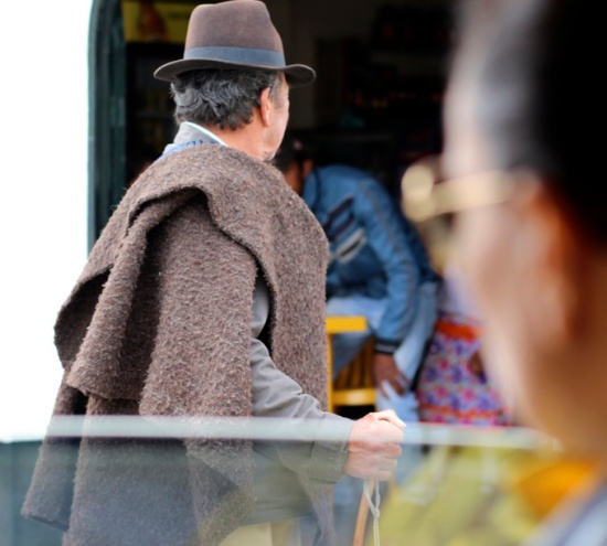 Colombian man with fedora and shawl