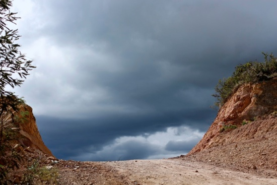 Dirt road and stormy sky