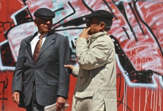 Men with caps, street art, Bogota, Colombia
